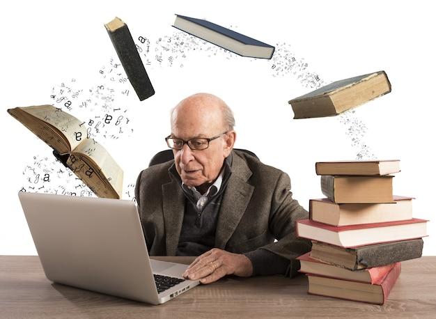 Anciano con computadora y libros volando