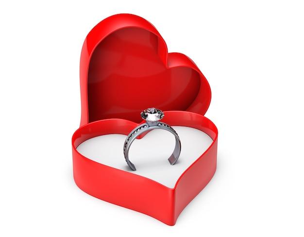 Anillos de boda de diamantes en caja de san valentín sobre un fondo blanco.