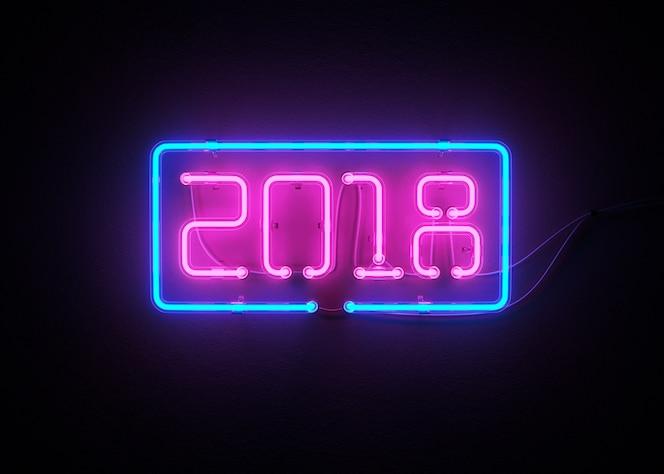 Año nuevo 2018 hecho de la representación 3d del alfabeto de neón
