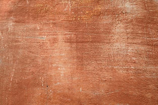 Antigua muralla de cemento de un edificio con pintura agrietada fondo envejecido y textura