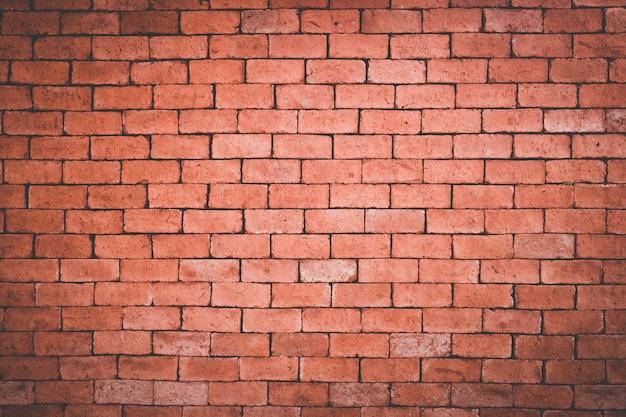 Antigua muralla de ladrillo naranja grunge