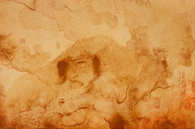 Antiguo fondo de grunge de papel marrón. textura de color café líquido abstracto.