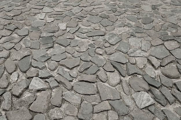 Antiguo fondo de pavimento de piedra gris