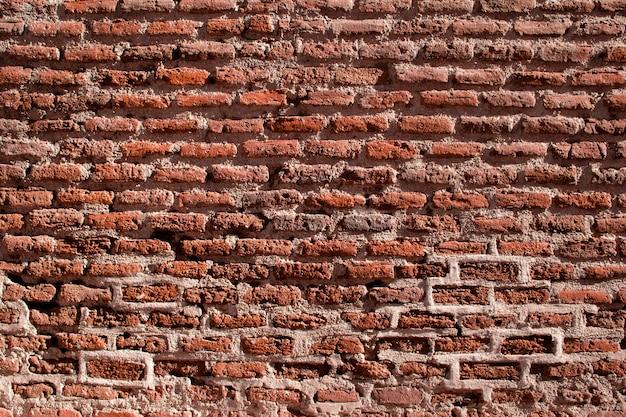 Antiguo muro de ladrillo de color naranja y rojo. textura.