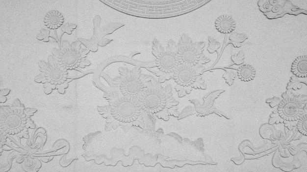 Antiguo pájaro chino tallado en piedra