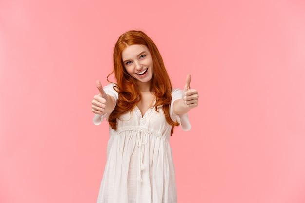 Apoyo tu elección. carismática emocionada, feliz pelirroja mujer vestida de blanco