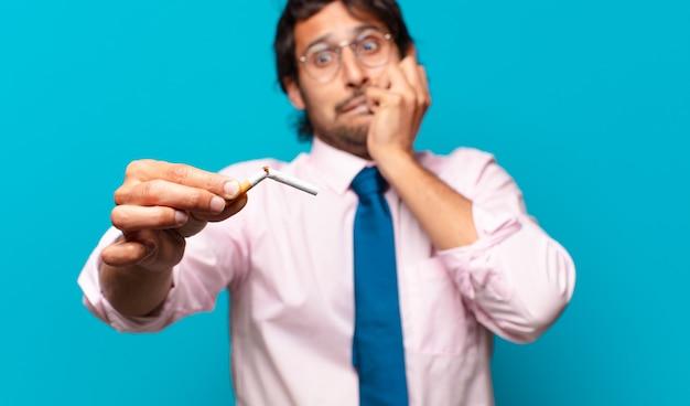 Apuesto hombre de negocios adulto. dejar de fumar concepto