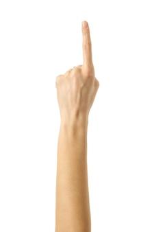 Apuntando hacia arriba. mano de mujer con manicura francesa gesticulando aislado sobre fondo blanco. parte de la serie