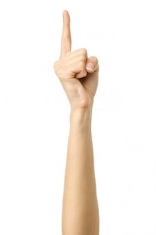 Apuntando hacia arriba. mujer mano gesticular aislado en blanco
