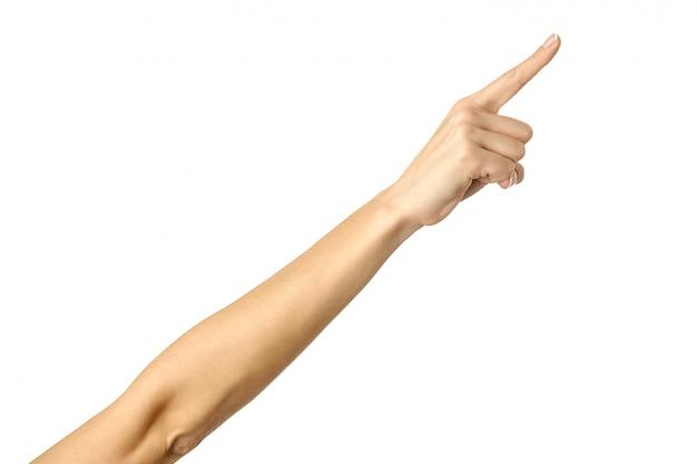 Apuntando a la derecha. mujer mano gesticular aislado en blanco