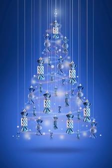Árbol de navidad de cuento de hadas hecho de juguetes de dulces navideños en una pared azul.