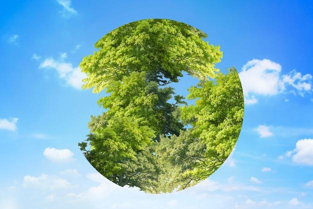 Árboles gráficos del día de la tierra en forma de círculo de globo sobre fondo de cielo remezclado de medios