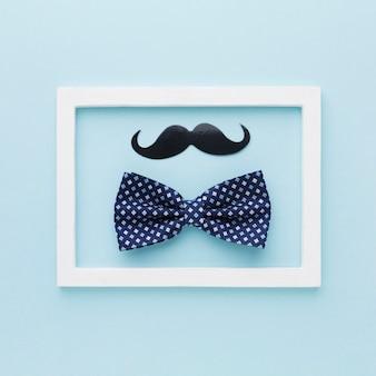 Arco y bigote sobre fondo azul