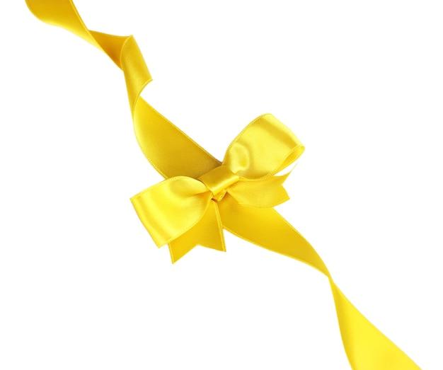Arco de cinta amarilla aislado en blanco