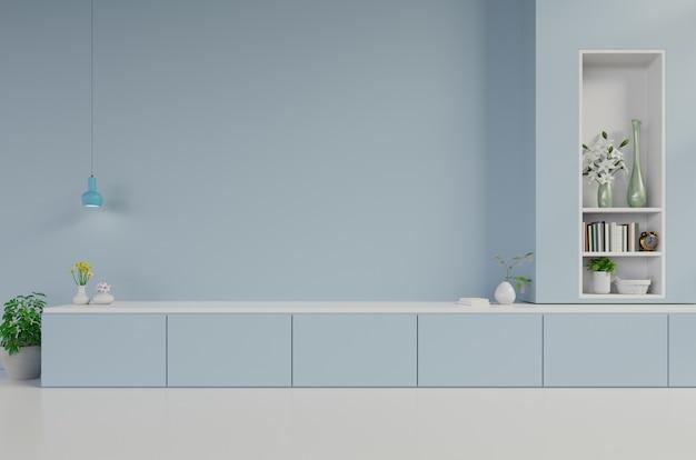 Armarios y pared para tv en salón, paredes azules.
