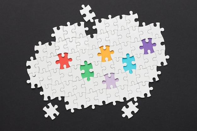 Arreglo de diversidad con diferentes piezas de rompecabezas.