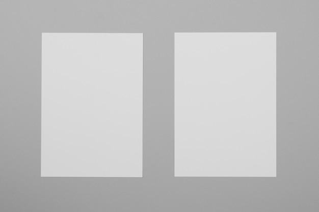 Arreglo plano de hojas de papel blanco