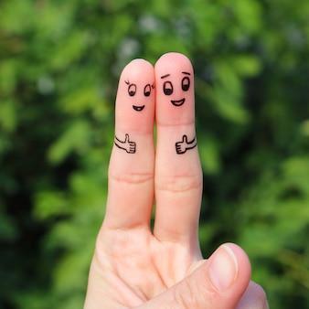 Arte del dedo de la feliz pareja mostrando los pulgares para arriba