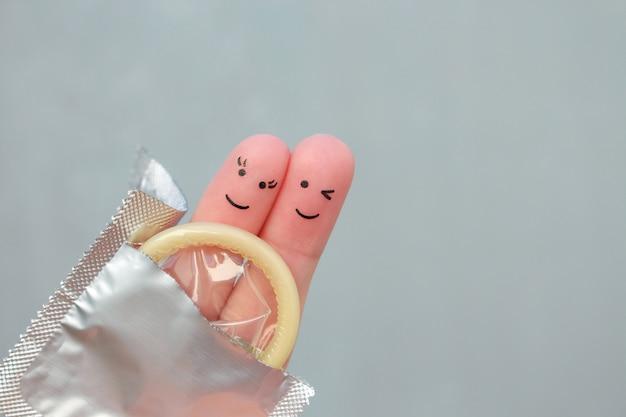 Arte de los dedos de la feliz pareja. concepto de sexo seguro.