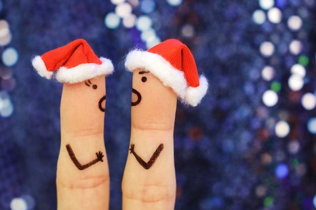 El arte de los dedos de la pareja celebra la navidad