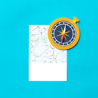 Arte de papel artesanal de un mapa y una brújula.