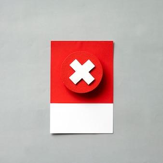 Arte de papel artesanal de una x roja.