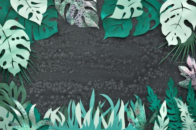 Arte de papel, marco con exóticas hojas tropicales con espacio de texto en la oscuridad