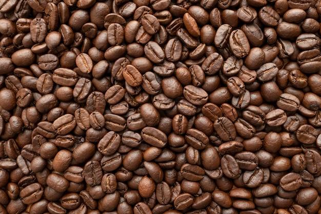 Asado de los granos de café para el fondo. de cerca.