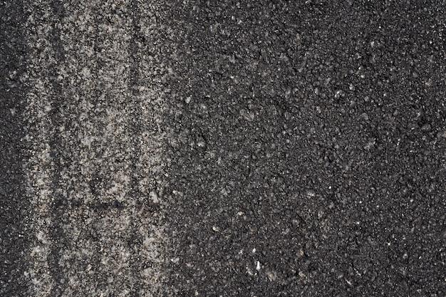 Asfalto con rastro de coche como textura de fondo