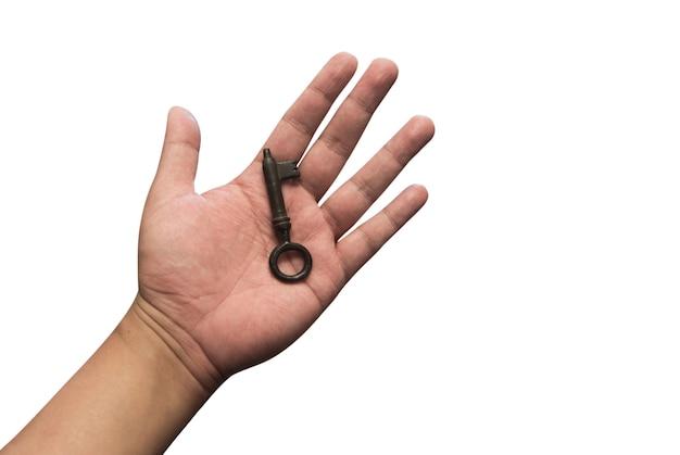 Asimiento de la mano vieja llave sobre fondo blanco aislado incluye ruta. tengo la clave del concepto de éxito
