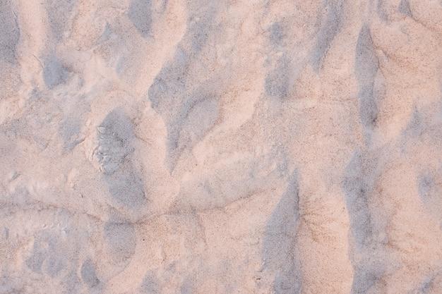 Atardecer en la playa. textura de arena