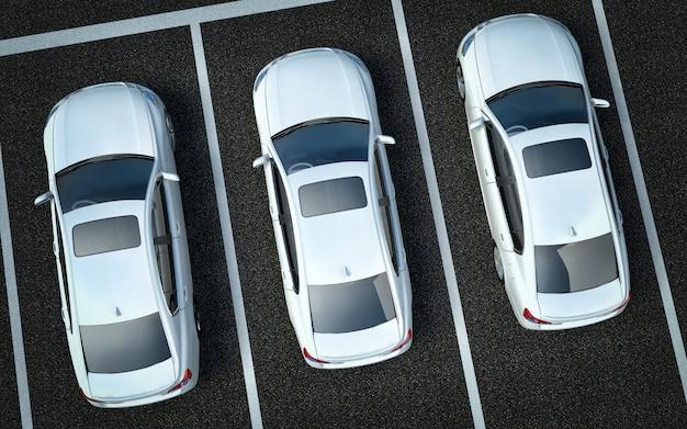 Autos blancos en un lugar de estacionamiento