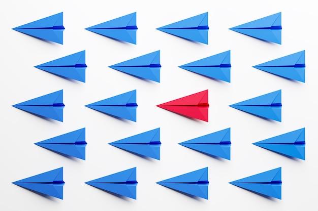 Aviones de papel azul sobre un fondo blanco con uno rojo en el centro. concepto de liderazgo. render 3d.