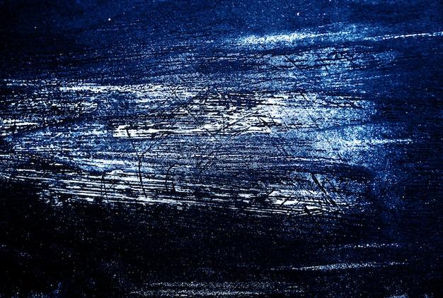 Azul oscuro y blanco trazo de pincel textura de fondo abstracto.