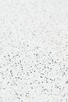 Azulejo con textura de granito blanco con manchas negras