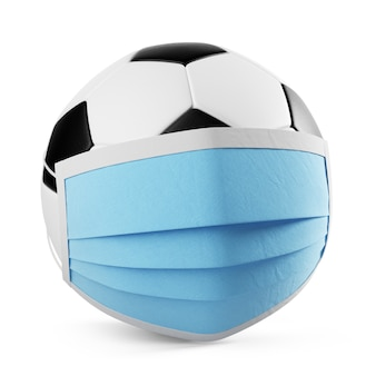 Balón de fútbol con una máscara médica aislada, 3d