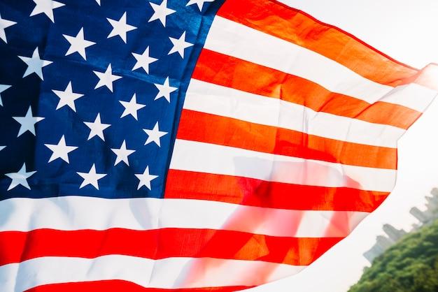 Bandera americana con sol