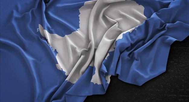 Bandera de la antártida arrugado sobre fondo oscuro 3d render
