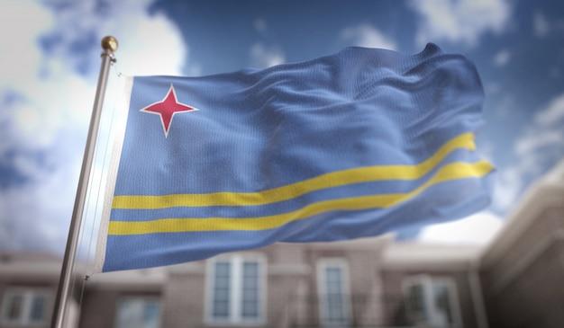 Bandera de aruba representación 3d en el fondo del edificio de cielo azul