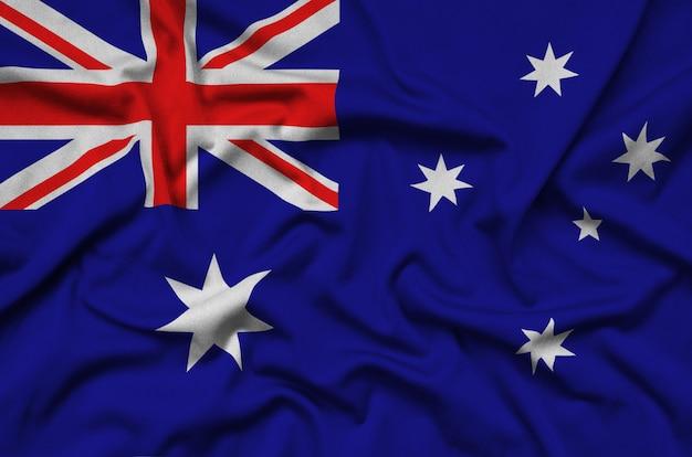 La bandera de australia está representada en una tela de tela deportiva con muchos pliegues.