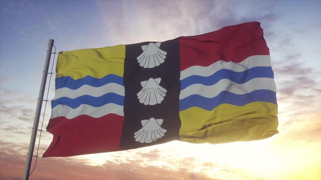 Bandera de bedfordshire, inglaterra, ondeando en el fondo del viento, el cielo y el sol. representación 3d.