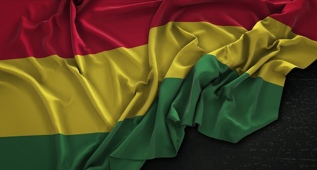 Bandera de bolivia arrugado sobre fondo oscuro 3d render