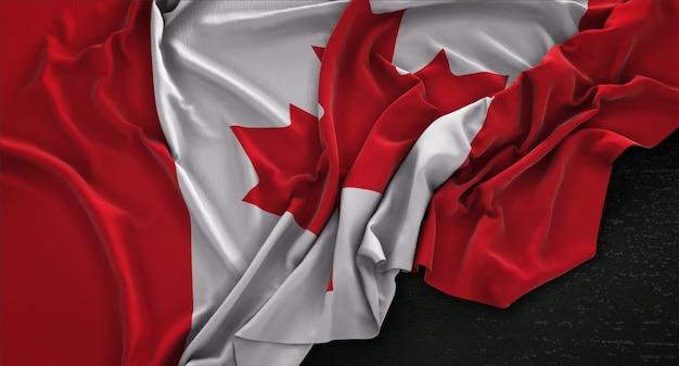 Bandera de canadá arrugado sobre fondo oscuro 3d render