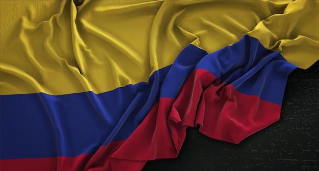 Bandera de colombia arrugado sobre fondo oscuro 3d render