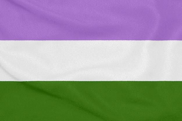 Bandera comunitaria lgbt genderqueer pride en tela texturizada. símbolo del orgullo
