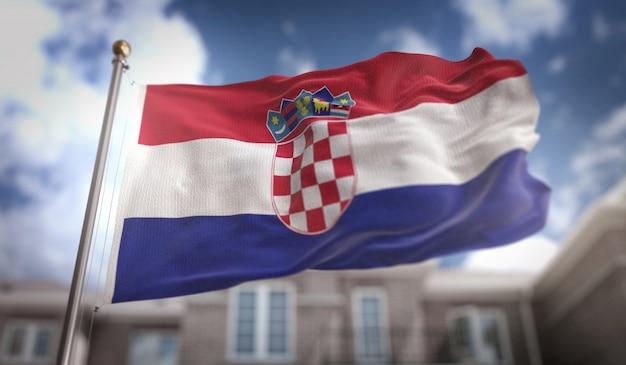 Bandera de croacia representación 3d sobre fondo de construcción de cielo azul