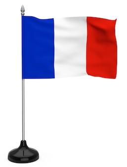 Bandera de francia colgada en el asta de la bandera sobre un fondo blanco.