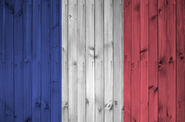 Bandera de francia en la vieja pared de madera