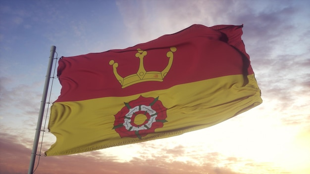 Bandera de hampshire, inglaterra, ondeando en el fondo del viento, el cielo y el sol. representación 3d.