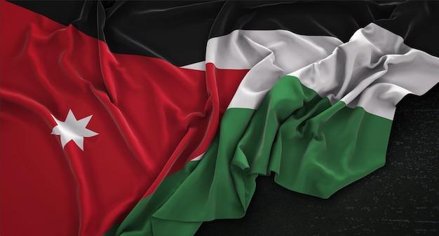 Bandera de jordania arrugado sobre fondo oscuro 3d render